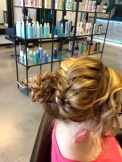 Messy Bun hair style done at our Rio Rancho Hair Salon